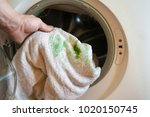 man puts a dirty towel  stained ... | Shutterstock . vector #1020150745