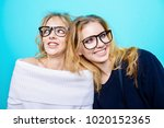 two pretty cheerful girls in... | Shutterstock . vector #1020152365