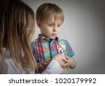 little boy at the doctor ... | Shutterstock . vector #1020179992