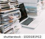 piles of paperwork in the... | Shutterstock . vector #1020181912