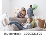 happy family renovating their... | Shutterstock . vector #1020221602