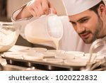selective focus of confectioner ... | Shutterstock . vector #1020222832
