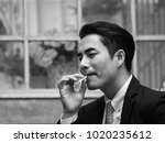 young businessman smoking and... | Shutterstock . vector #1020235612