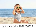 little girl with sunglasses on... | Shutterstock . vector #1020250822