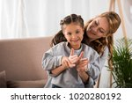 beautiful happy mother and... | Shutterstock . vector #1020280192