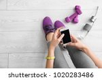 young woman with mobile phone... | Shutterstock . vector #1020283486