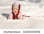 the child fell into the snow... | Shutterstock . vector #1020343456