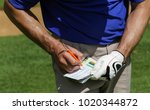 Golfer Keeping Score On...
