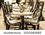 tables and chairs at an old cafe | Shutterstock . vector #1020360085