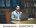arabic man working in library... | Shutterstock . vector #1020379075