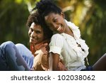 south american couple sitting... | Shutterstock . vector #102038062