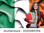 happy female student holdimg...   Shutterstock . vector #1020389296