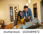 young couple shopping online on ... | Shutterstock . vector #1020389872