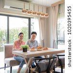 young asian couples eating... | Shutterstock . vector #1020395455