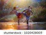 the fighter tying tape around... | Shutterstock . vector #1020428005