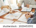 business people discussing data ... | Shutterstock . vector #1020453592