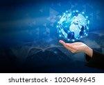 business woman hand holding... | Shutterstock . vector #1020469645