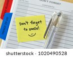 text don't forget to smile... | Shutterstock . vector #1020490528