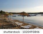 sand beach  sun beds and boats...   Shutterstock . vector #1020493846