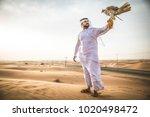 arabian man walking  in the... | Shutterstock . vector #1020498472
