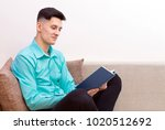 portrait of a smiling young man ... | Shutterstock . vector #1020512692