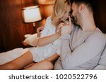 loving couple on the bed in the ... | Shutterstock . vector #1020522796