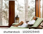 pretty young woman relaxing on... | Shutterstock . vector #1020525445