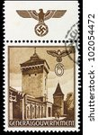 GERMANY - CIRCA 1940: A stamp printed in Germany showing buildings of Poland (Florian's Gate, Krakow) , circa 1940 - stock photo