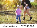 mom and the baby are walking in ... | Shutterstock . vector #1020545305