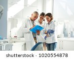 medical dentist team in dental... | Shutterstock . vector #1020554878