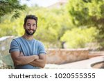 young man smiling at countryside | Shutterstock . vector #1020555355
