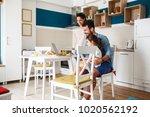 family breakfast.young parents... | Shutterstock . vector #1020562192