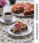the famous plum pie... | Shutterstock . vector #1020568462