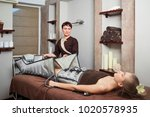 a woman lying down doing... | Shutterstock . vector #1020578935