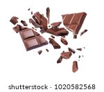 chocolate broken into pieces in ... | Shutterstock . vector #1020582568