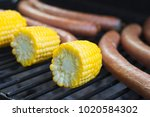 corn cob and sausages on grill  ... | Shutterstock . vector #1020584302