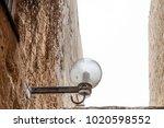 lamp on street of stone old...   Shutterstock . vector #1020598552