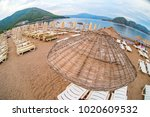 sun loungers on a beach in... | Shutterstock . vector #1020609532