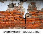 old ruined brick wall with... | Shutterstock . vector #1020613282