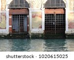 two old rusty gates in venice... | Shutterstock . vector #1020615025