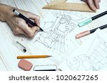 designer makes a sketch of the... | Shutterstock . vector #1020627265