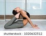 sports model girl doing asanas. ... | Shutterstock . vector #1020632512