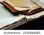 Small photo of Old book cover, vintage texture, isolated on black background. Old Jewish Talmud in Yiddish with Bible.