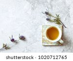 cup of tea and sea holly... | Shutterstock . vector #1020712765