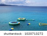Inflatable trampolines and other inflatable water recreation equipment floating in the bay, Montego Bay, Jamaica.