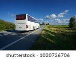 white bus traveling on asphalt... | Shutterstock . vector #1020726706