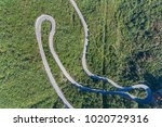 aerial view on road serpentine... | Shutterstock . vector #1020729316
