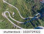 aerial view on road serpentine... | Shutterstock . vector #1020729322