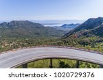 aerial view on road serpentine... | Shutterstock . vector #1020729376