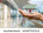 businessman holding house model ... | Shutterstock . vector #1020731512